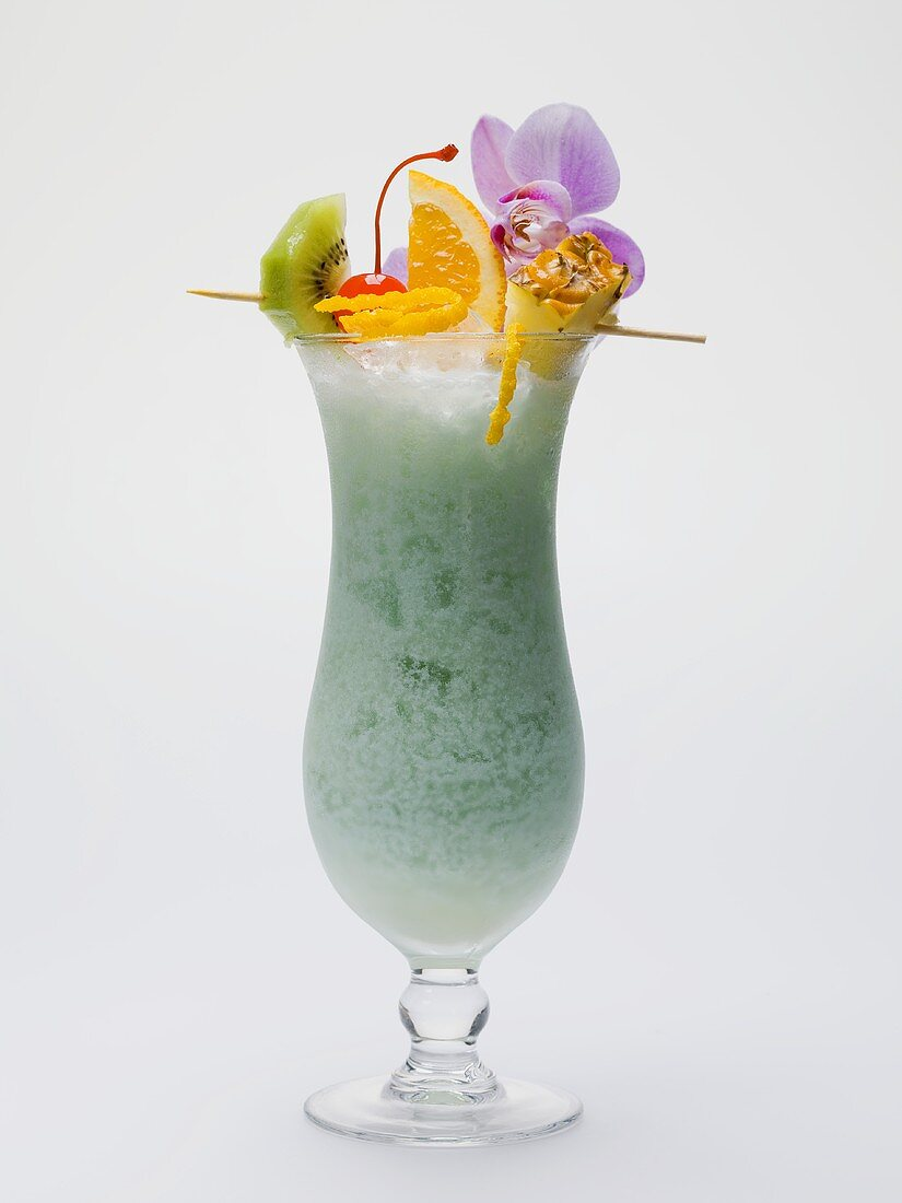 Long drink made with Blue Curaçao, with fruit skewer