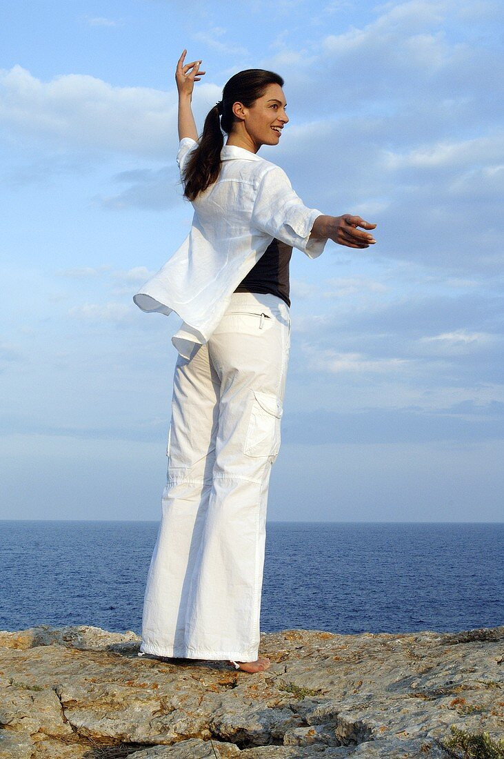 Woman doing relaxation exercises by the sea