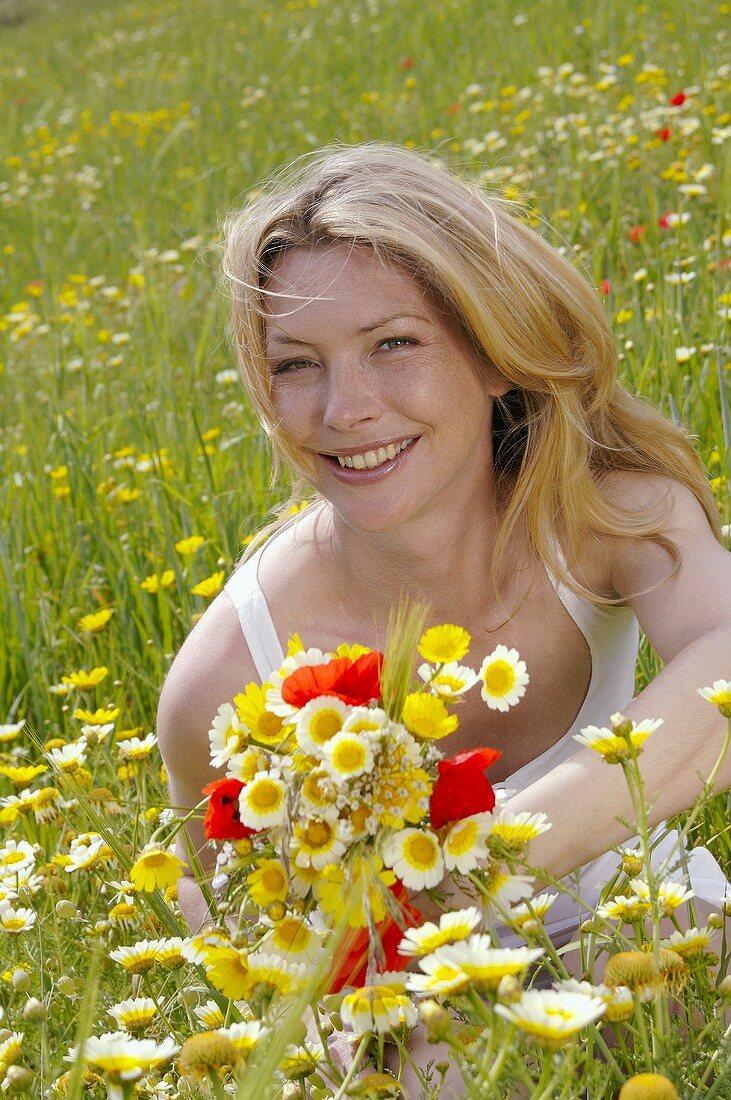 Woman in a wildflower meadow