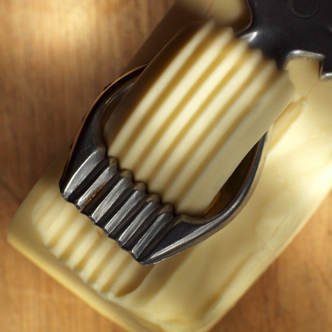 Butter curler making butter curl from block of butter