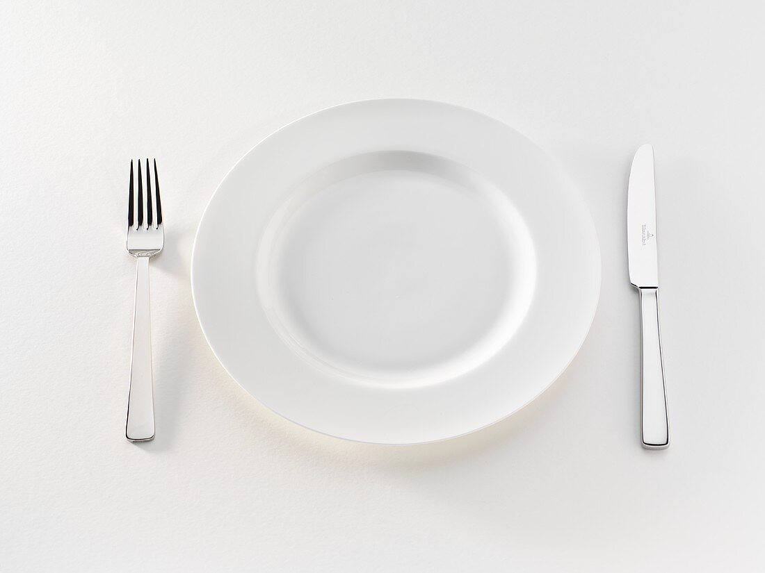 White plate with knife and fork
