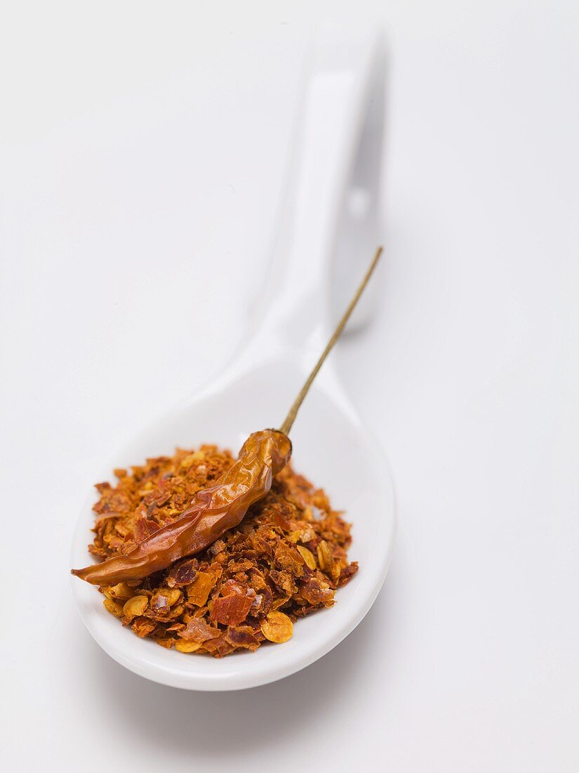 Chilli flakes and dried chilli on spoon