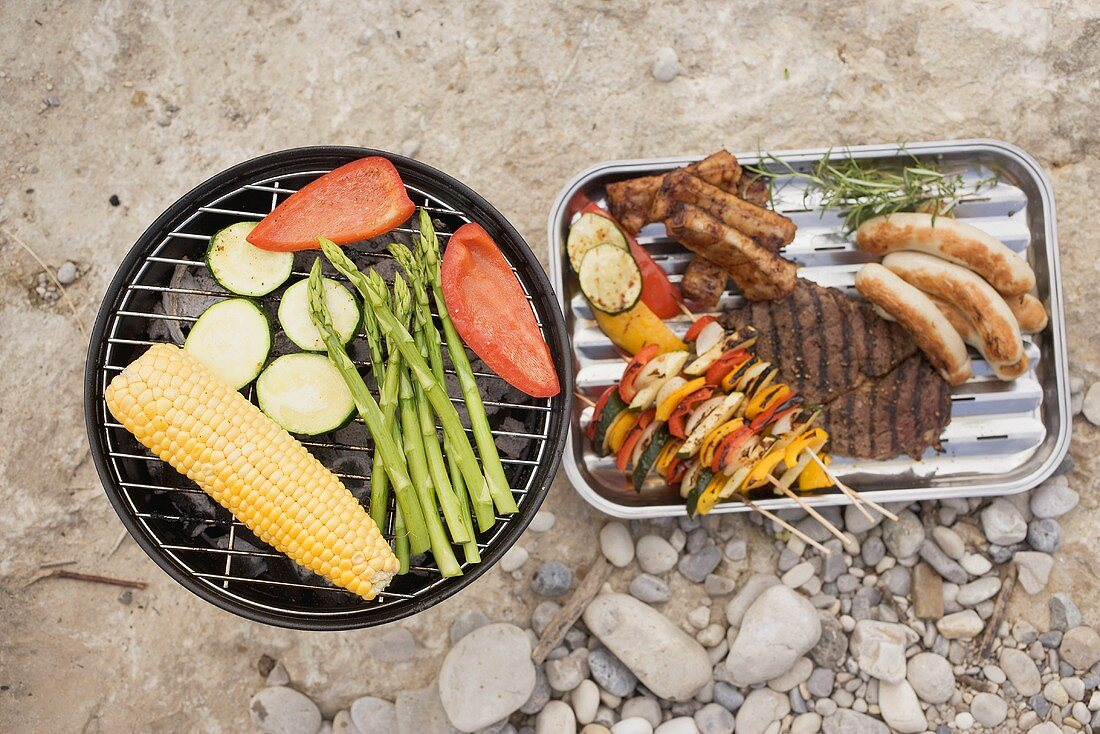 Vegetables on barbecue, grilled food in aluminium dish