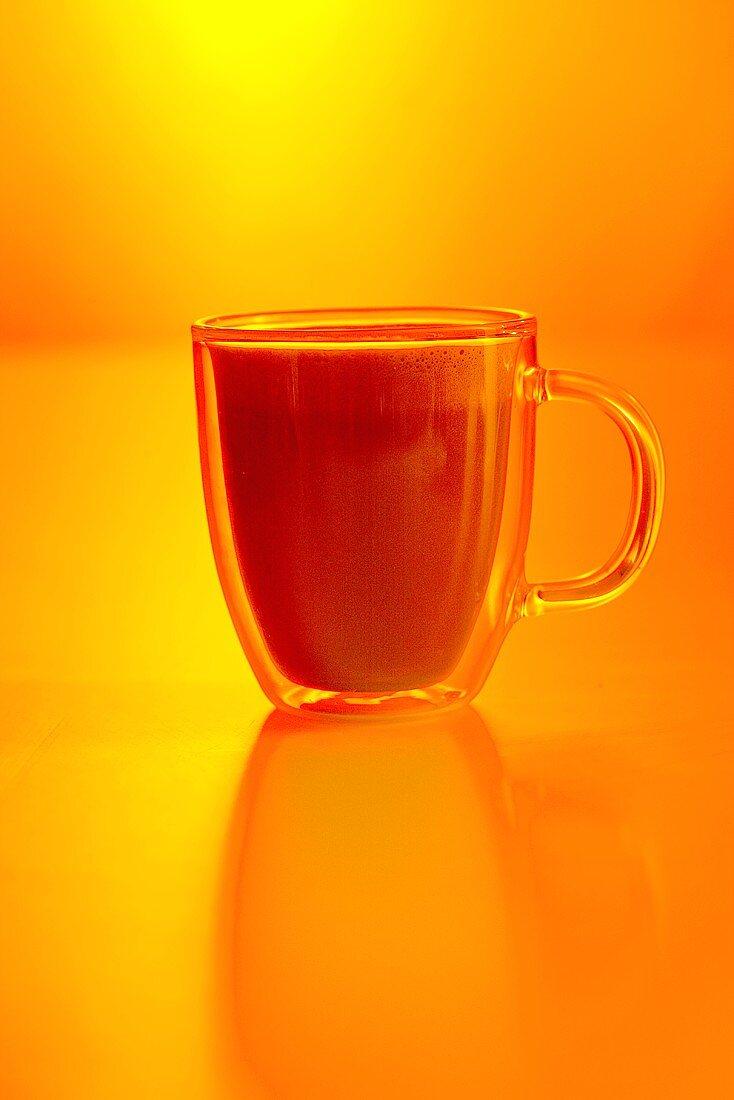 Coffee with orange liqueur and milk foam