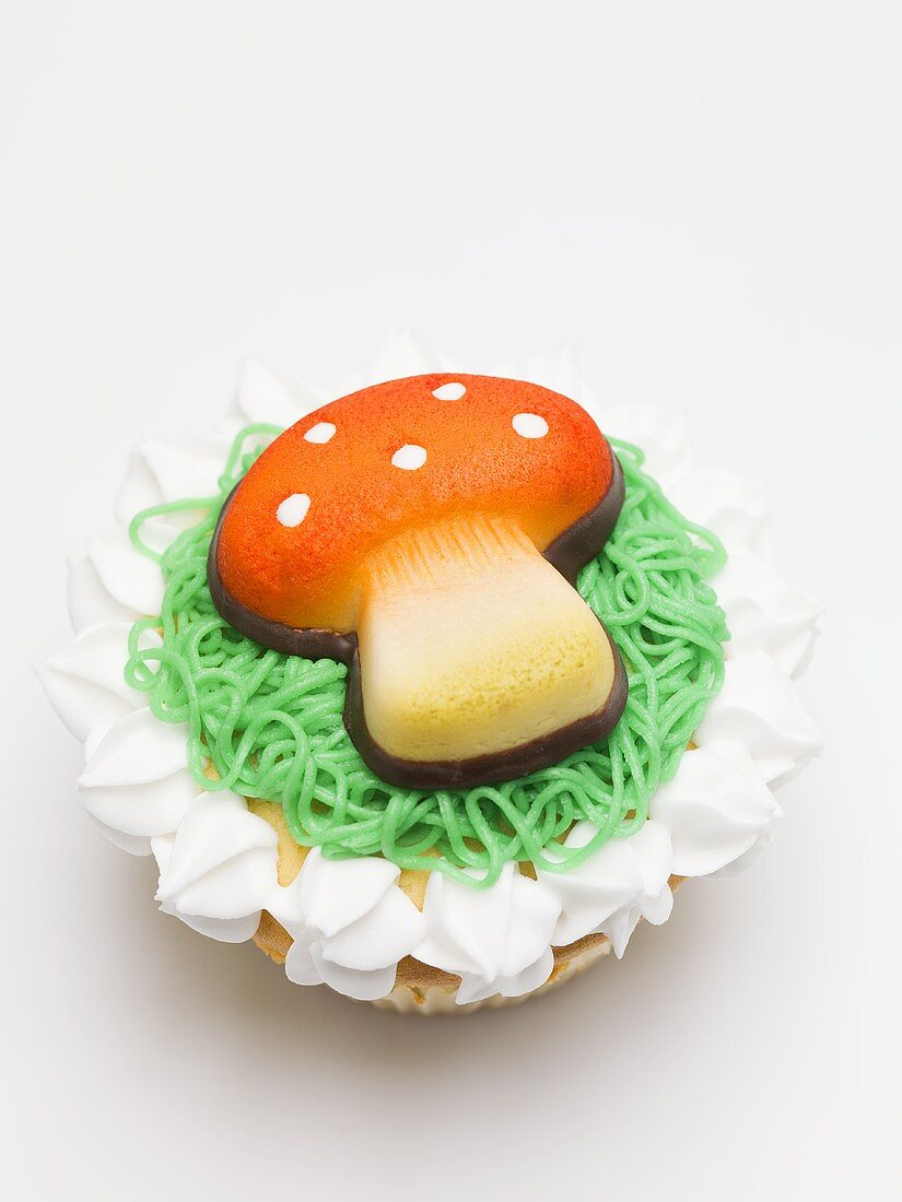 Cupcake with fly agaric mushroom for New Year's Eve