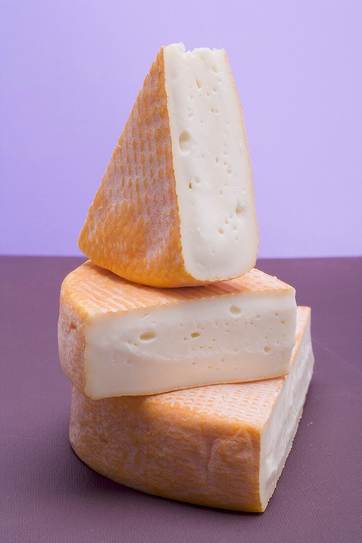 Three pieces of washed-rind cheese