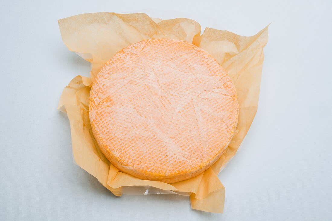 Washed-rind cheese in paper