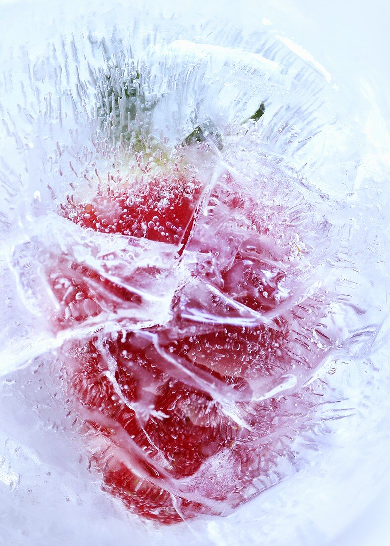 Strawberry in block of ice (close-up)