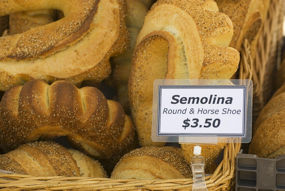Semolina Bread with Price Sign at Market