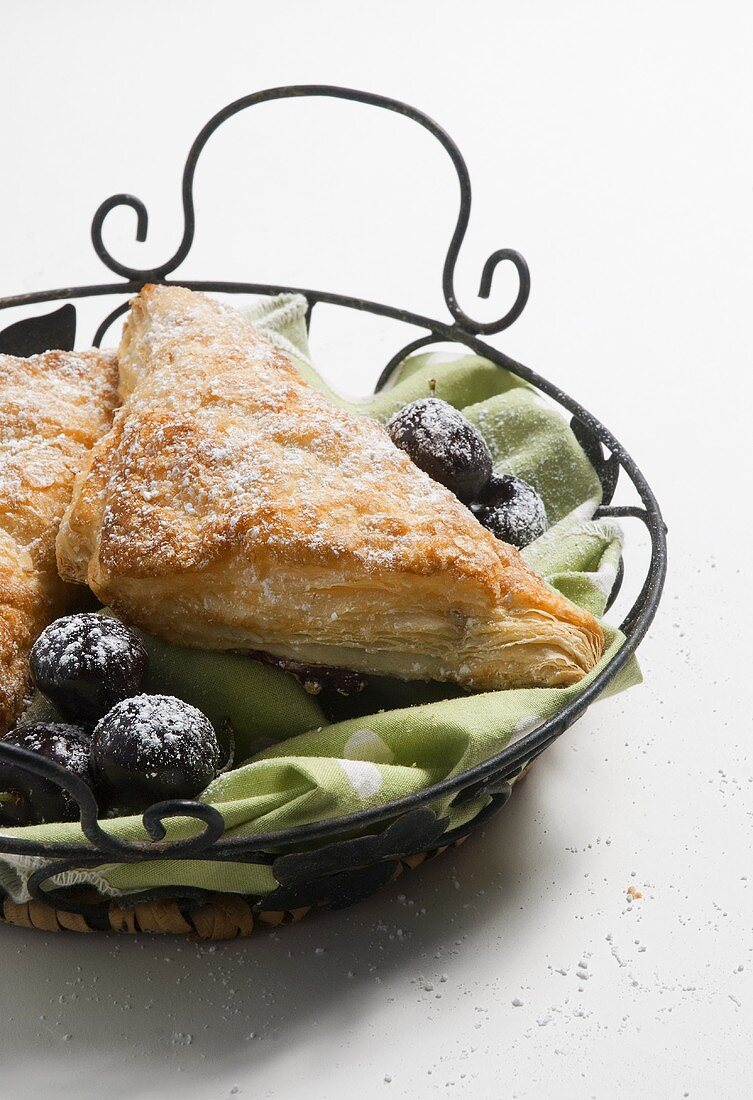 Turnovers with Powdered Sugar and Figs in Metal Basket