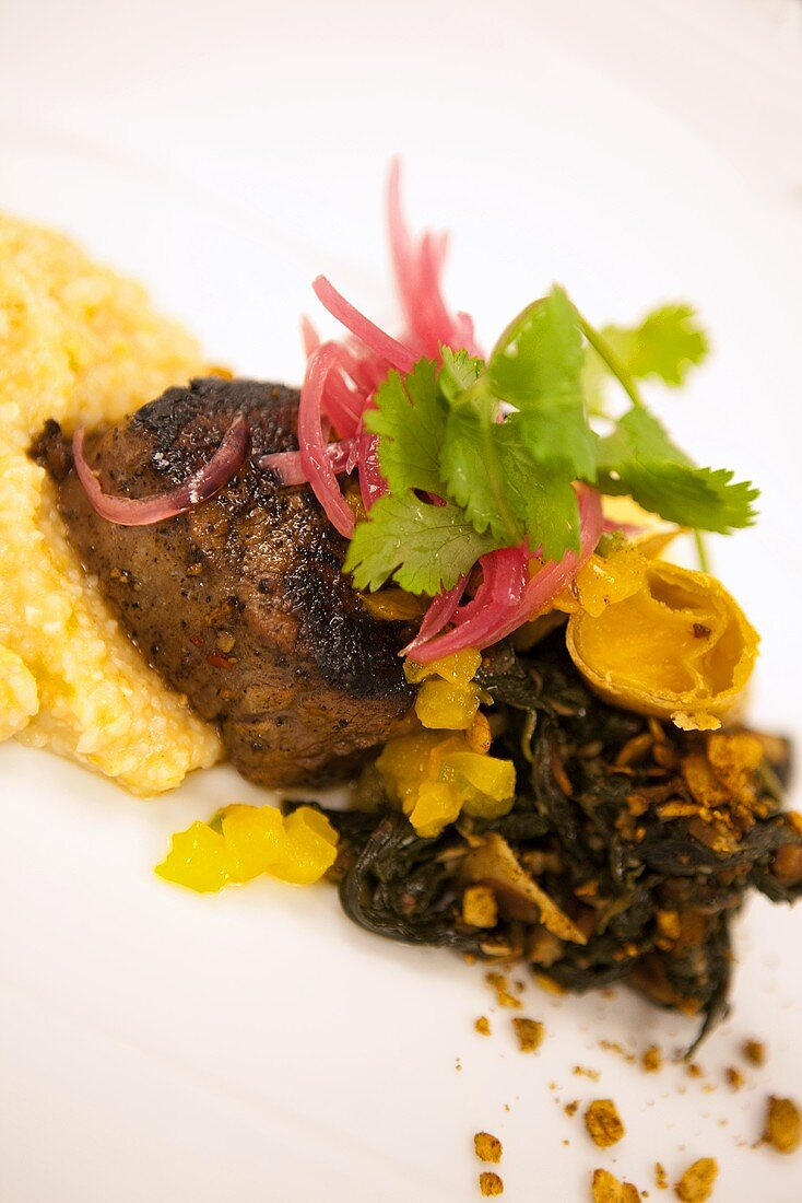 Maple Soaked Angus Beef Tenderloin on Jalapeno Grits and Greens
