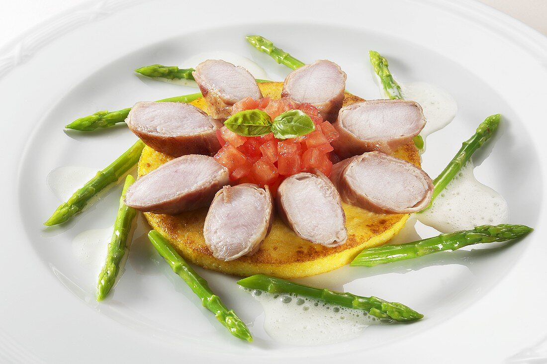 Rabbit loin & diced tomato on pancake, surrounded by asparagus
