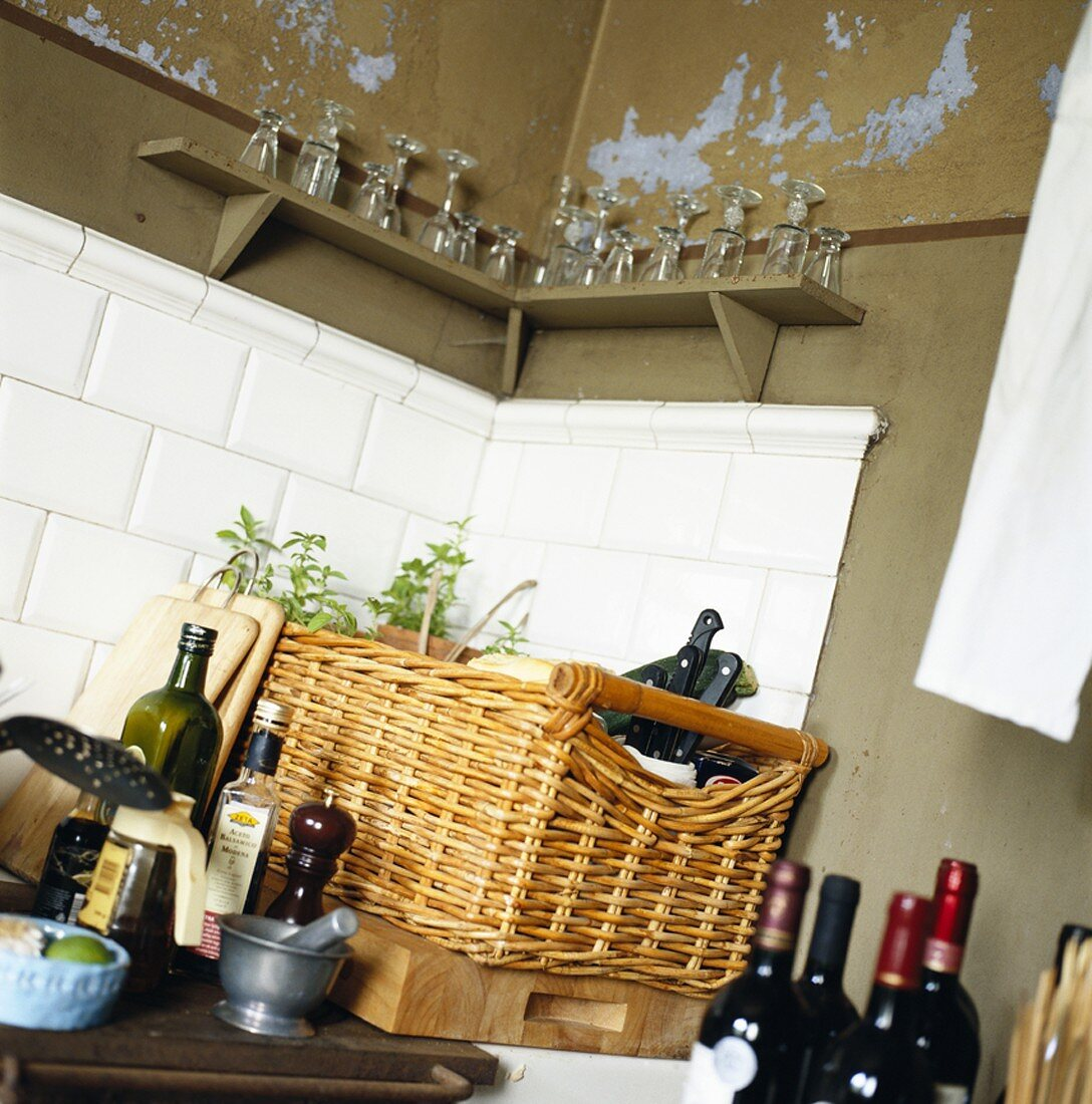 Various utensils, wine bottles and glasses in a kitchen