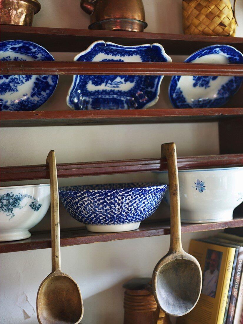 Blue and white porcelain on wooden shelves