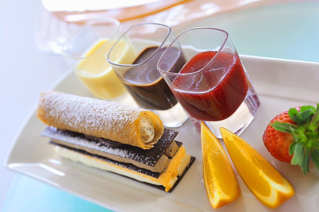 Coffee mousse dessert with pastries and fruit sauces