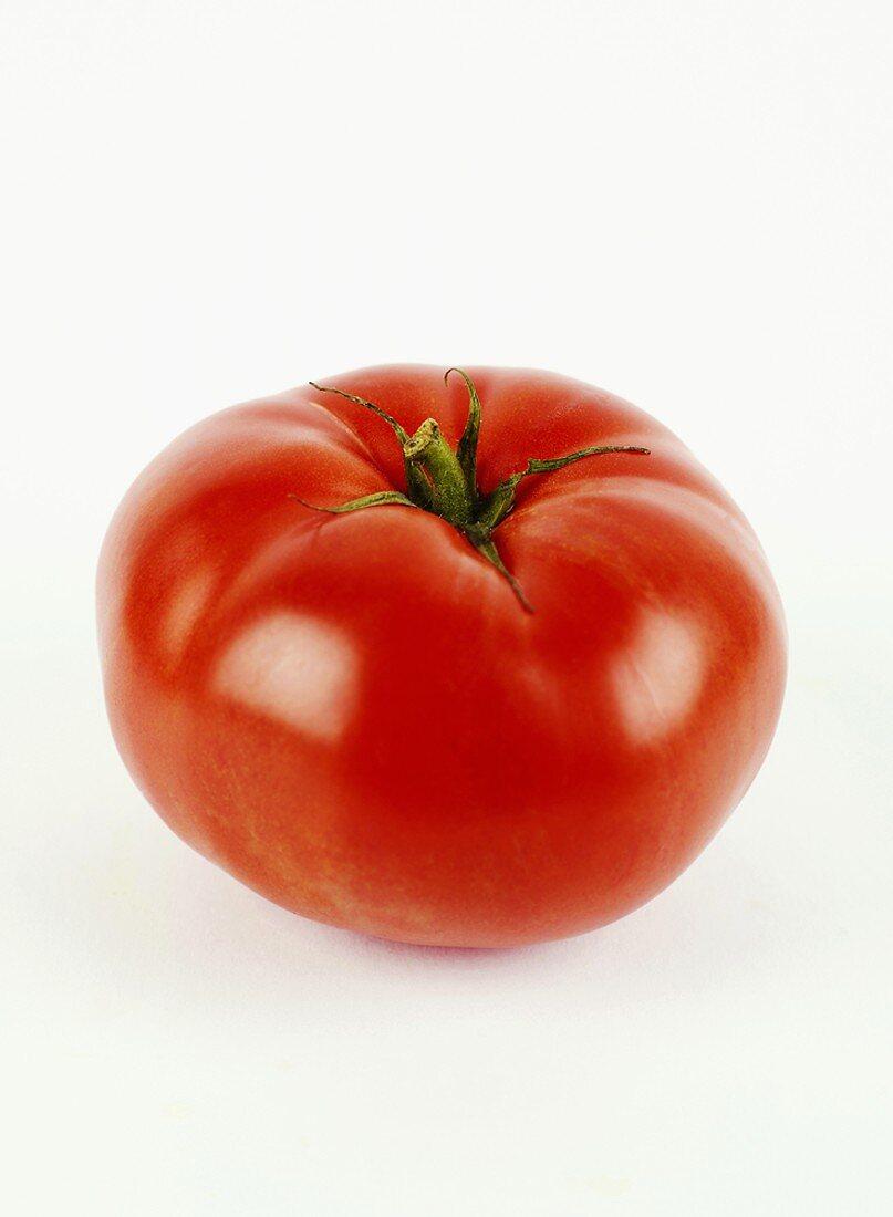 Whole Tomato on an Orange Dish Towel