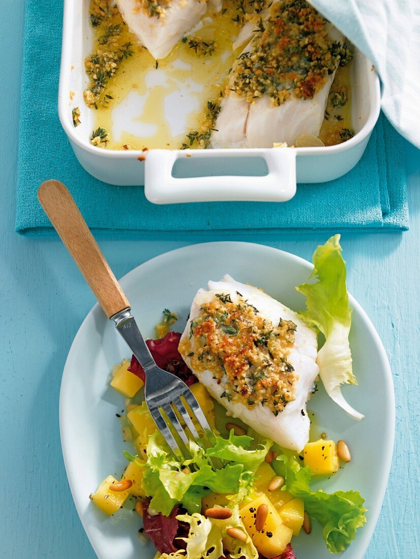 Cod fillet with a herb crust and a side salad