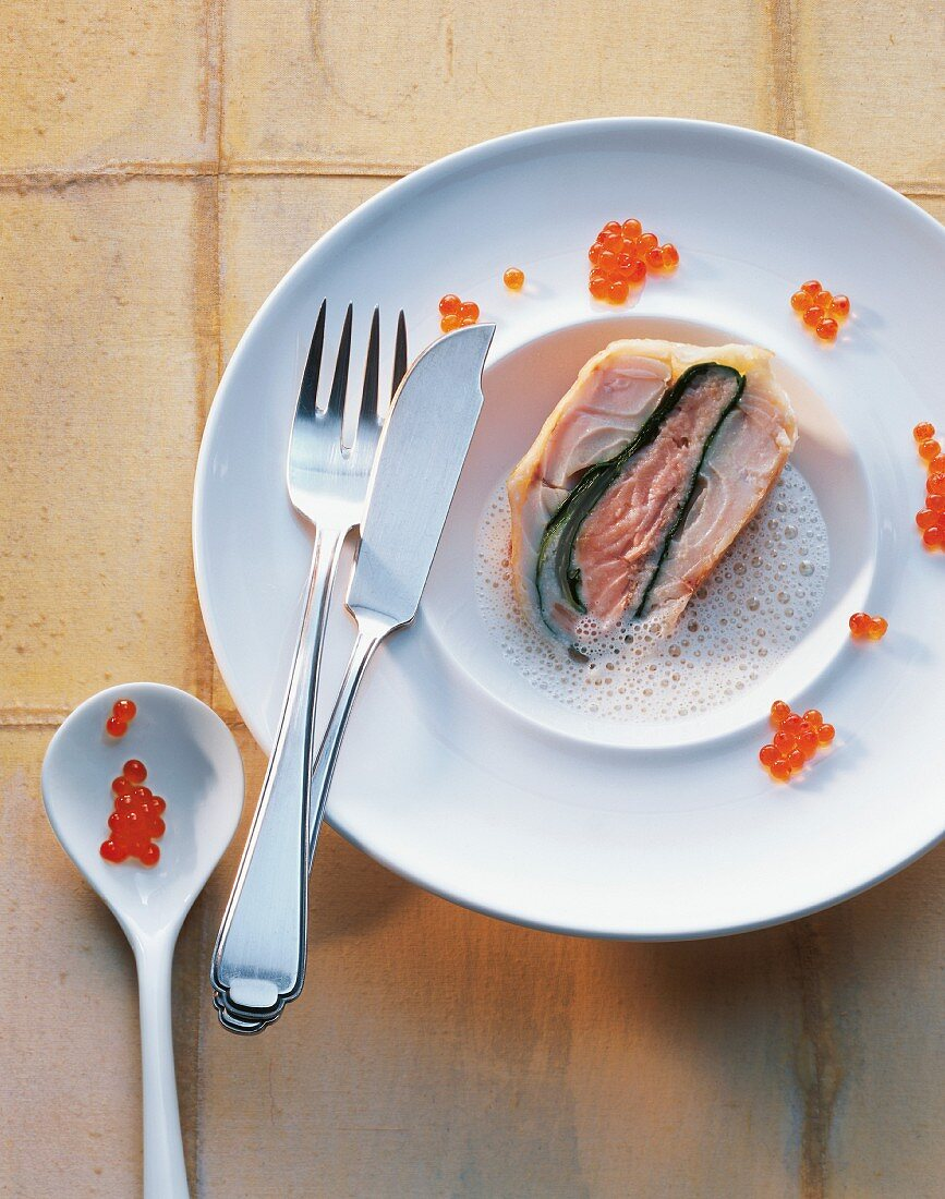 Fish strudel with salmon trout and zander in a foamy source