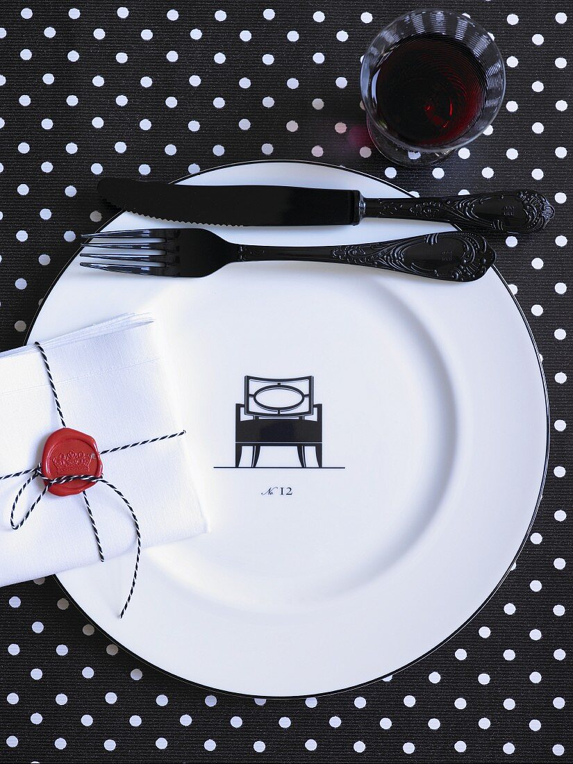 A white plate with a black silhouette