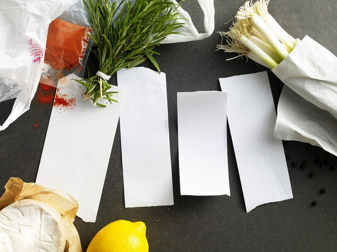 Four blank pieces of paper surrounded by ingredients for spicy dishes