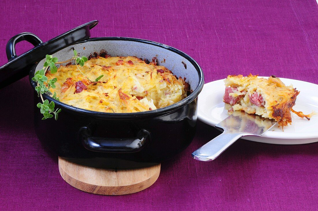 Rhineland potato pudding with smoked Metwurst susage (Germany)