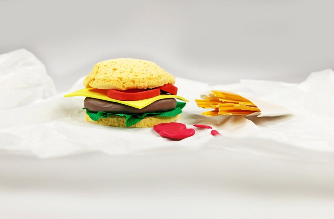 A burger and fries made from paper