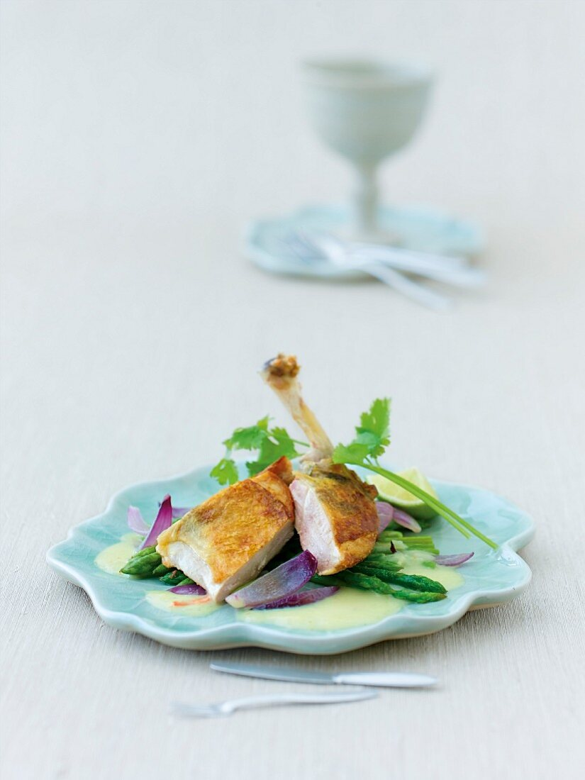 Guinea fowl with Thai asparagus on plate