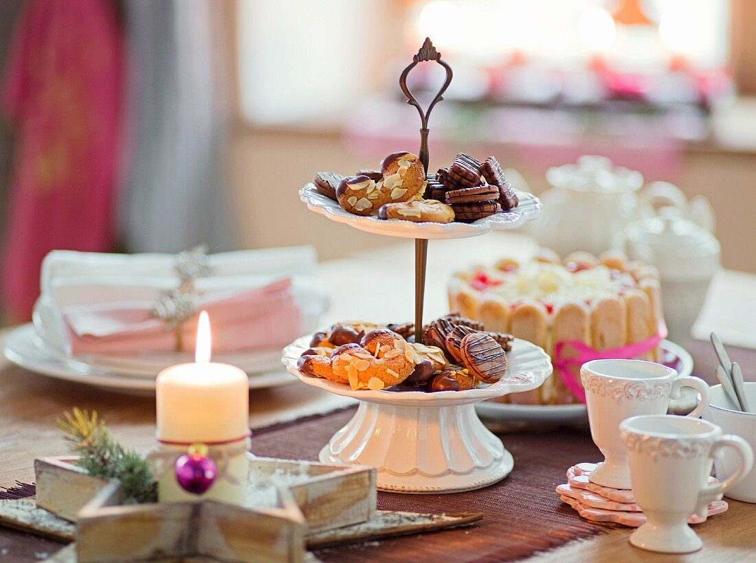 A table laid for Christmas with biscuits on a cake stand