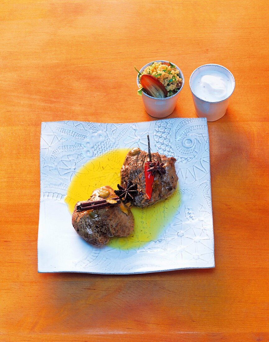 Lamb noisettes in argan oil with date couscous and spicy yoghurt