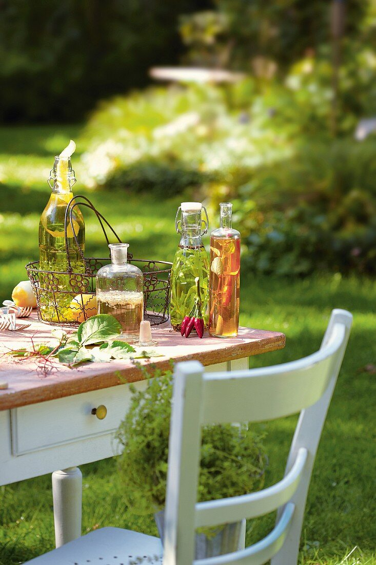 Homemade spiced oils and spiced vinegar on a table outside