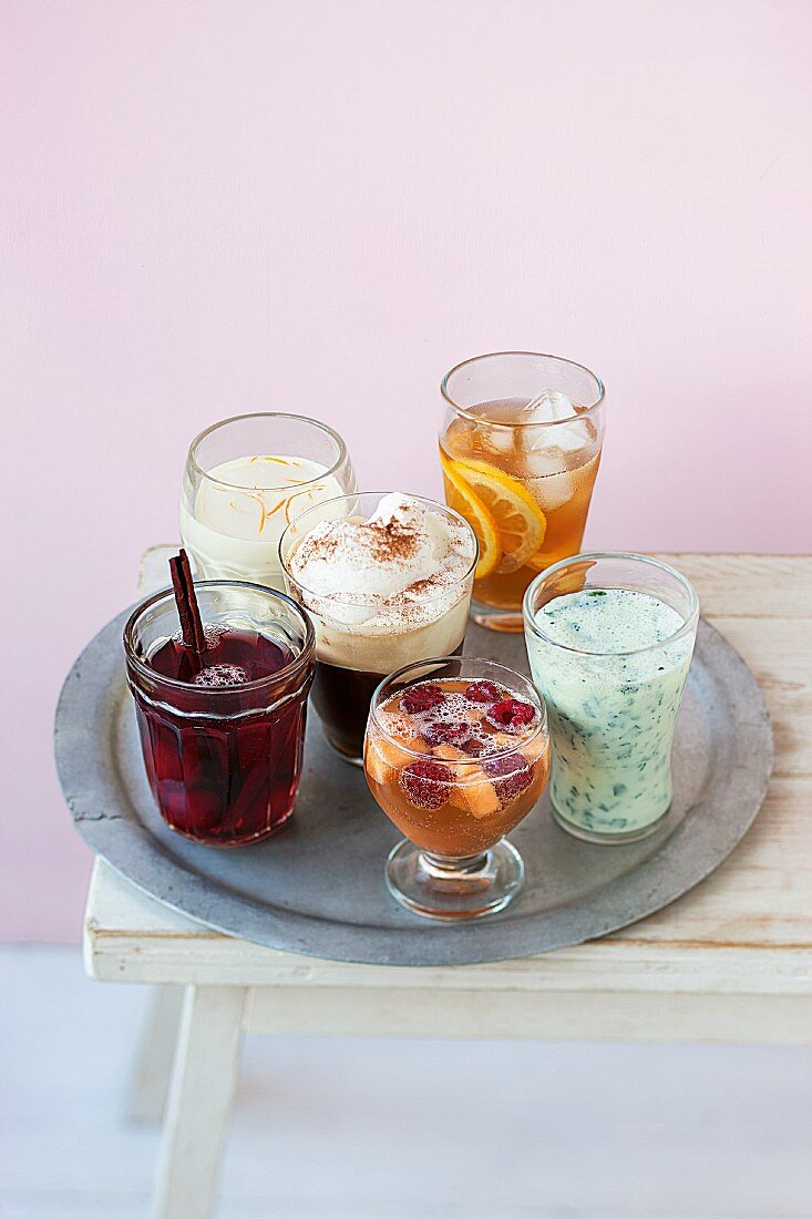 Six different drinks on a tray