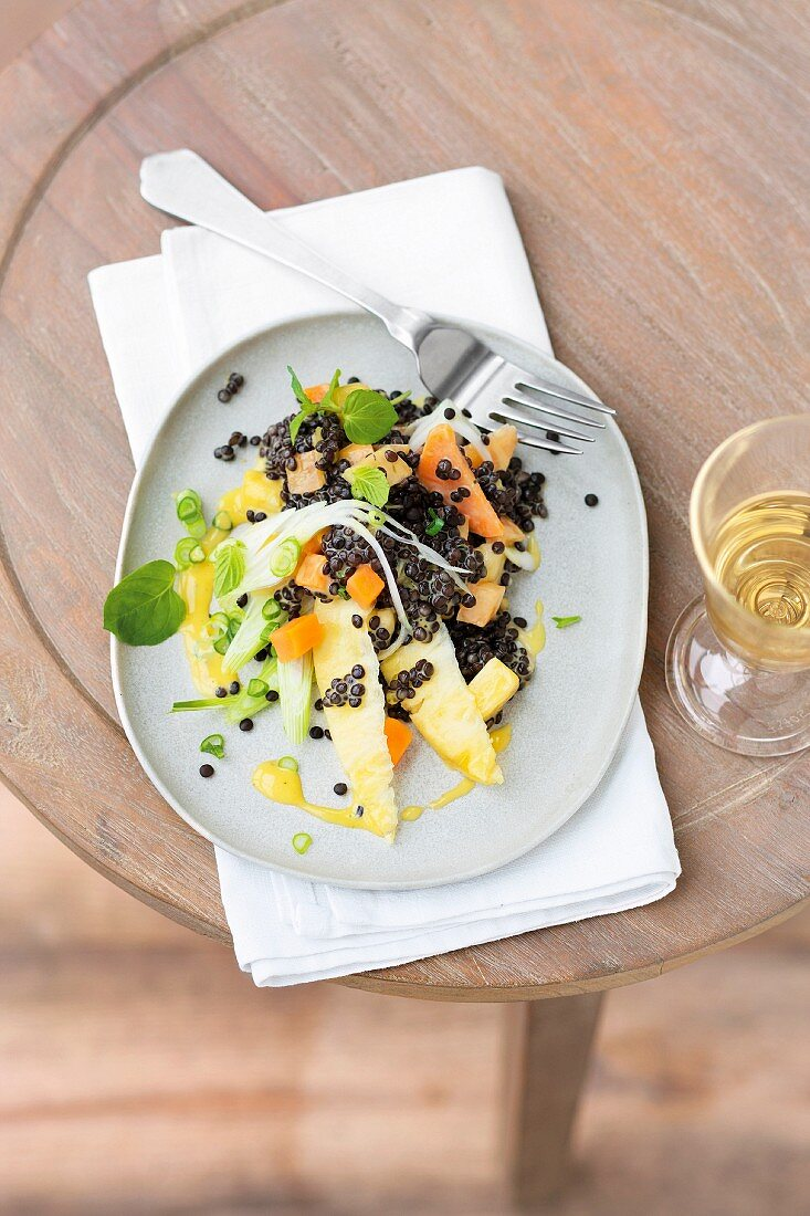 A salad of lentils, pineapples, persimmon and lime mayonnaise