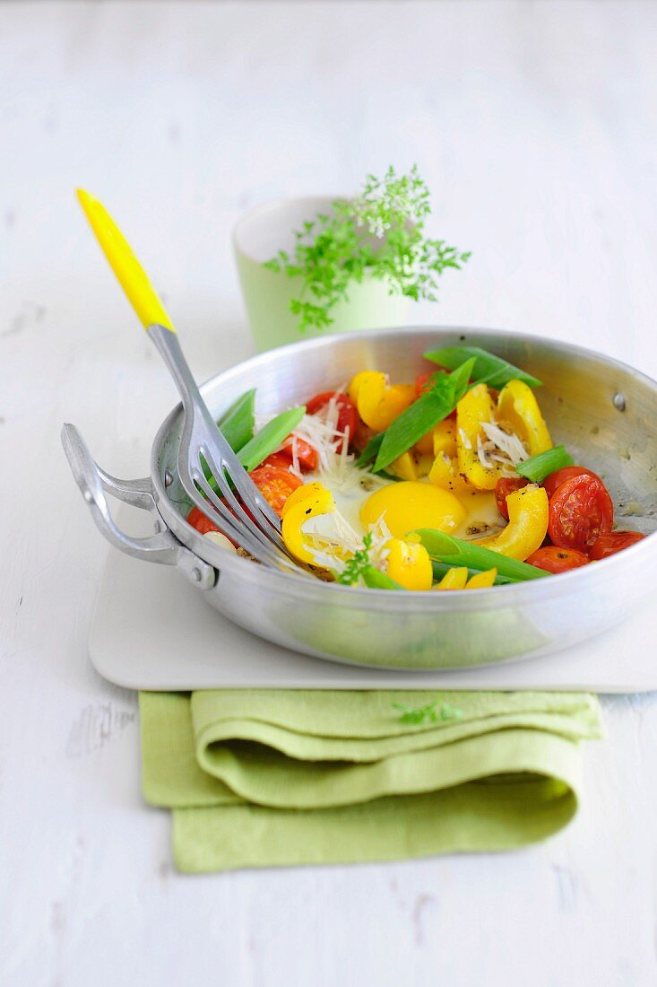 Fried vegetable with cherry tomatoes and peppers