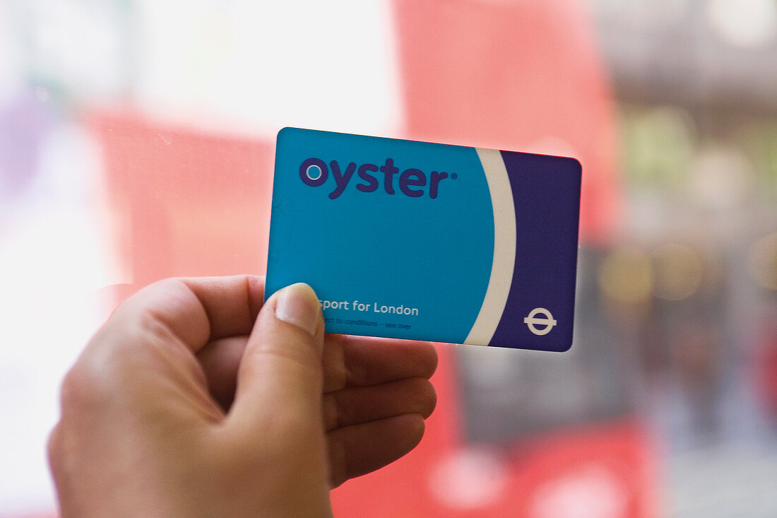 Close-up of hand holding Blue Oyster card in London, UK