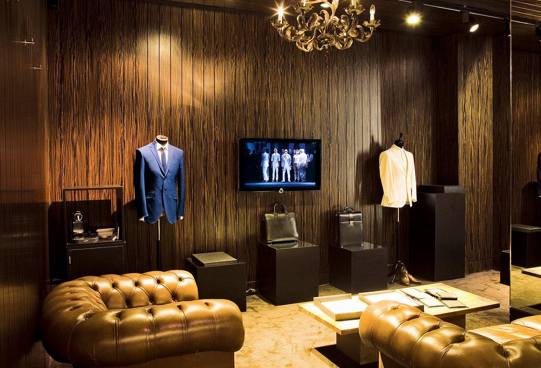 Room of fashion designer Ozwald Boateng with sofa, Dressmakers model and TV, London, UK