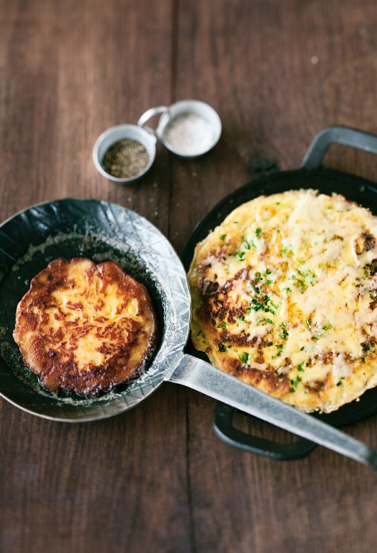 A potato pancake and a potato crepe with cheese and herbs