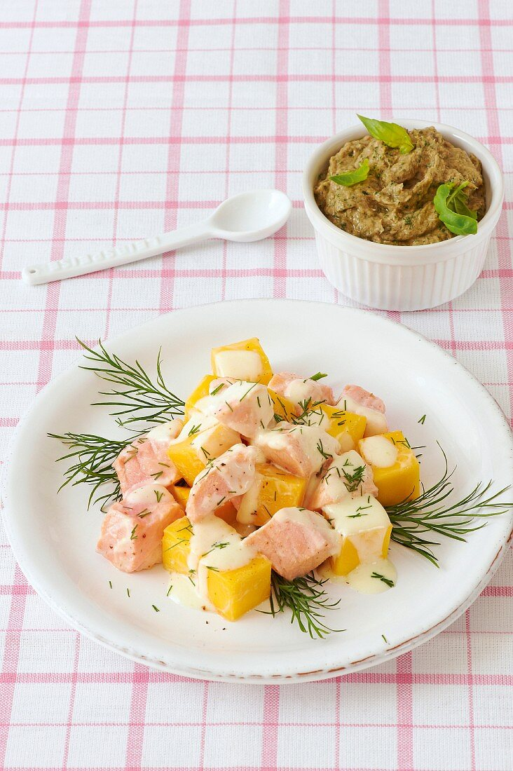 Salmon salad with mango served with a sardine dip with basil