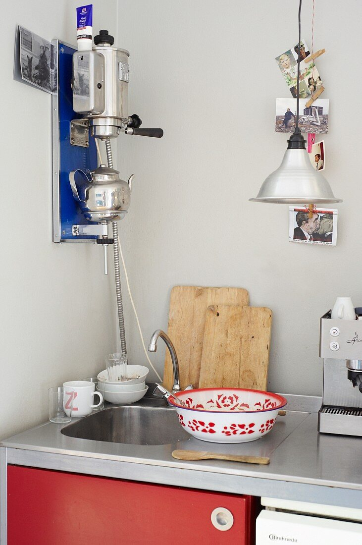 A sink and kitchen utensils in a student kitchen