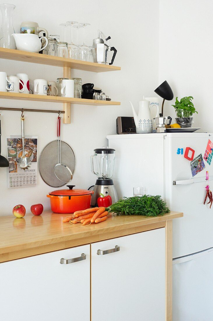 A work surface in a student kitchen with devices and utensils