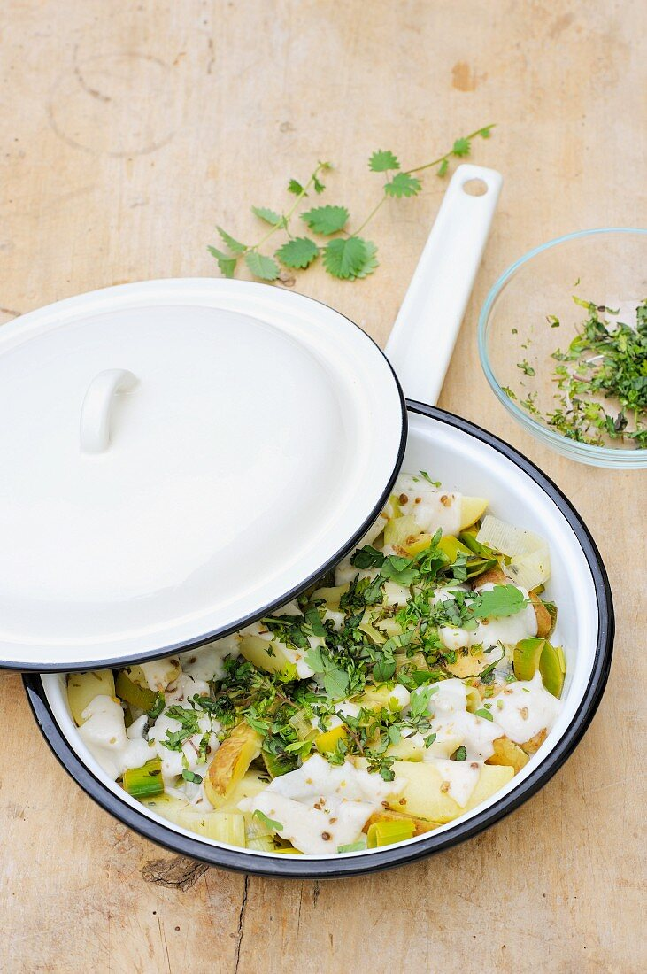 Fried leek and potatoes with spring herbs