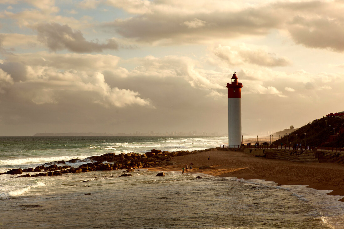 View of Umhlanga beach with rocks and lighthouse at dusk, South Africa