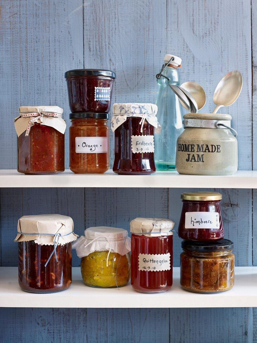 Various types of jam and jellies on a shelf