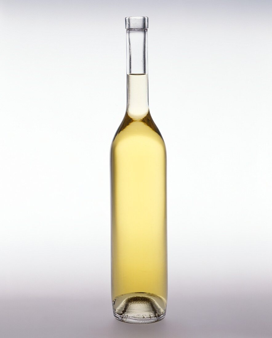 Olive Oil in tall narrow Glass Bottle