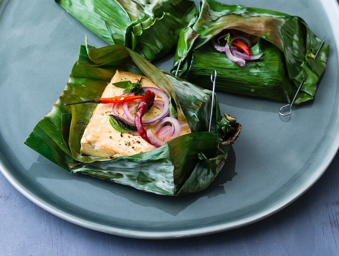 Spicy smoked sheep's cheese in a banana leaf