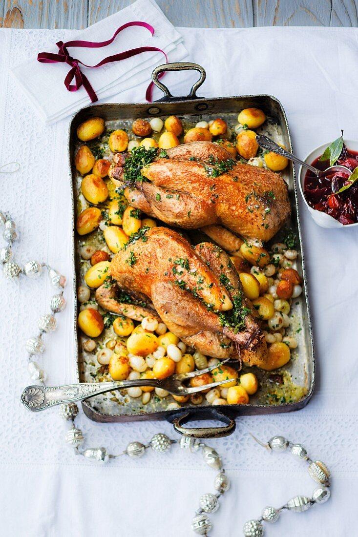 Guinea fowls with roast potatoes