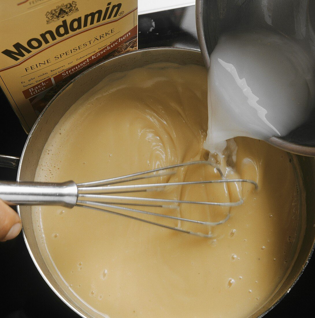 Thickening a sauce with flour and cornflour