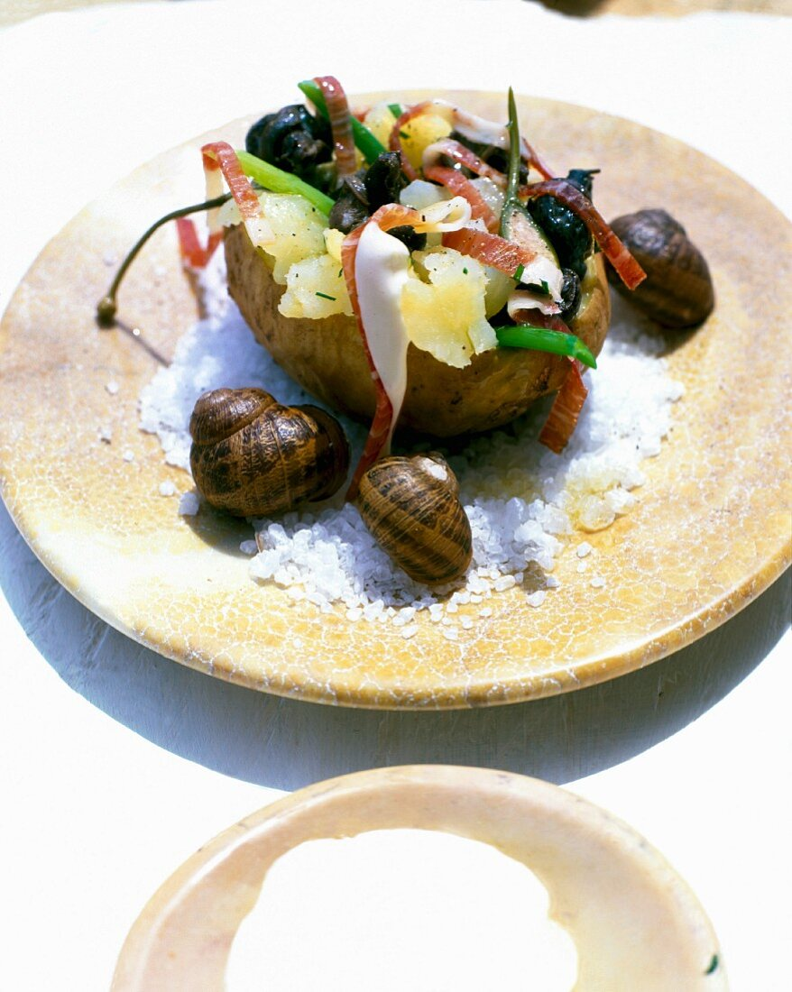 A baked potato with snails