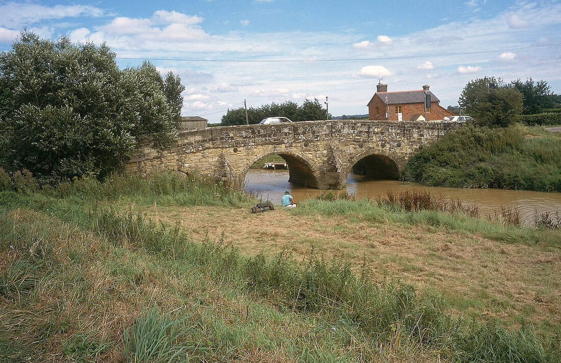 Landscape with small river and bridge