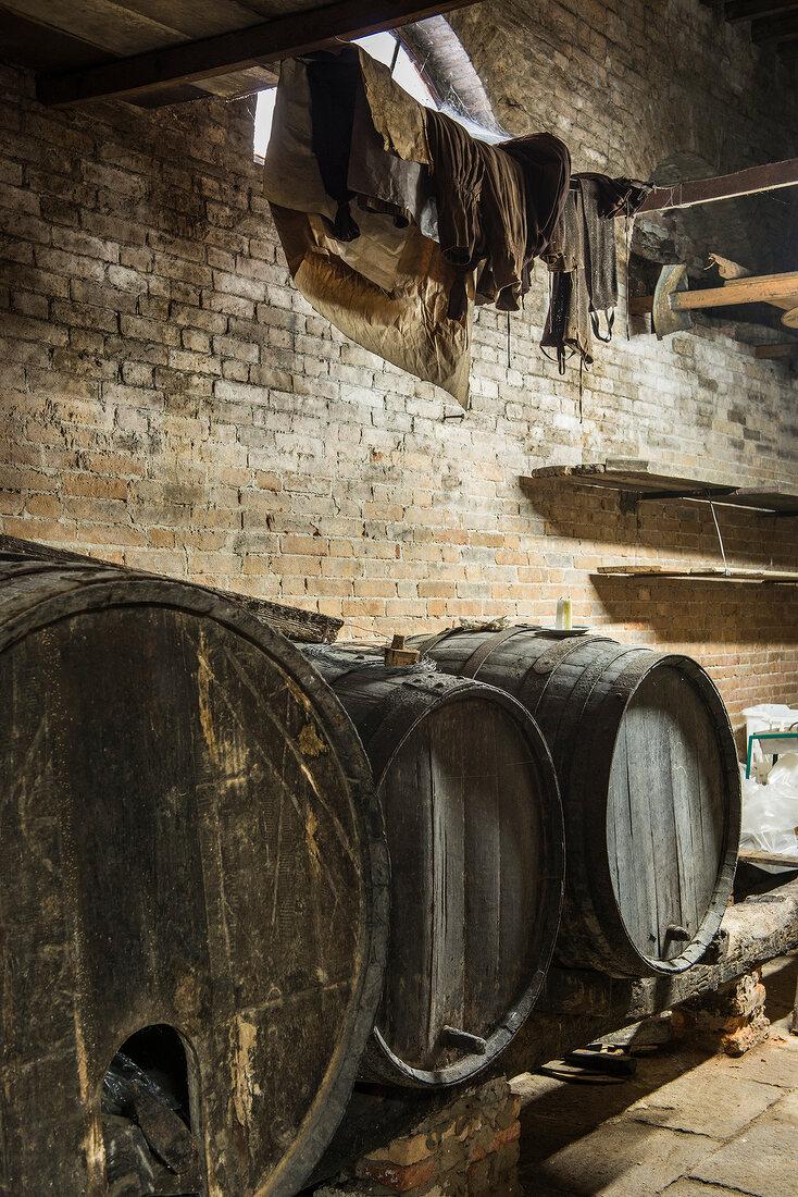 Wooden barrel in an old wine cellar