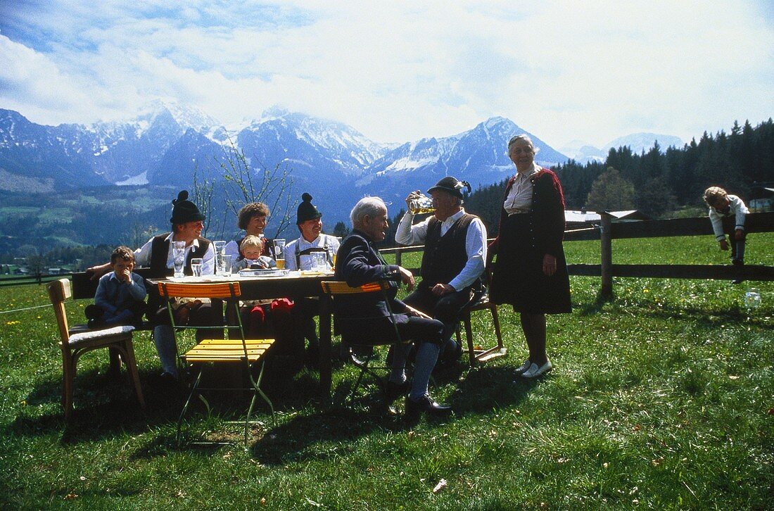 People Drinking Beer Outside; Mountains